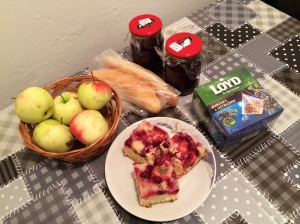 Apples from the tree in front, gooseberry pastries, homemade cherry and strawberry jams.