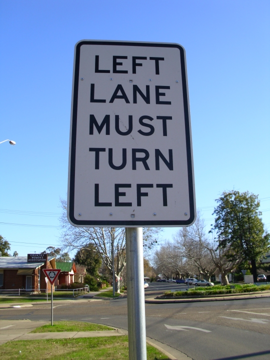 left_lane_must_turn_left_sign_located_at_the_ivan_jack_drive2c_trail_and_johnston_street_roundabout